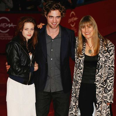 Actress Kristen Stewart, actor Robert Pattinson, director Catherine Hardwicke attends the Twilight Premiere in 2008.