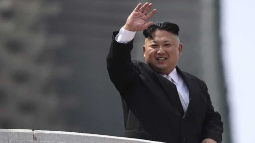 Kim Jong-Un waves to the crowd during a celebration in Pyongyang. (AAP)