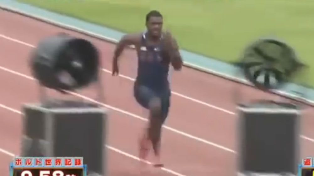 US sprinter breaks 100m world record