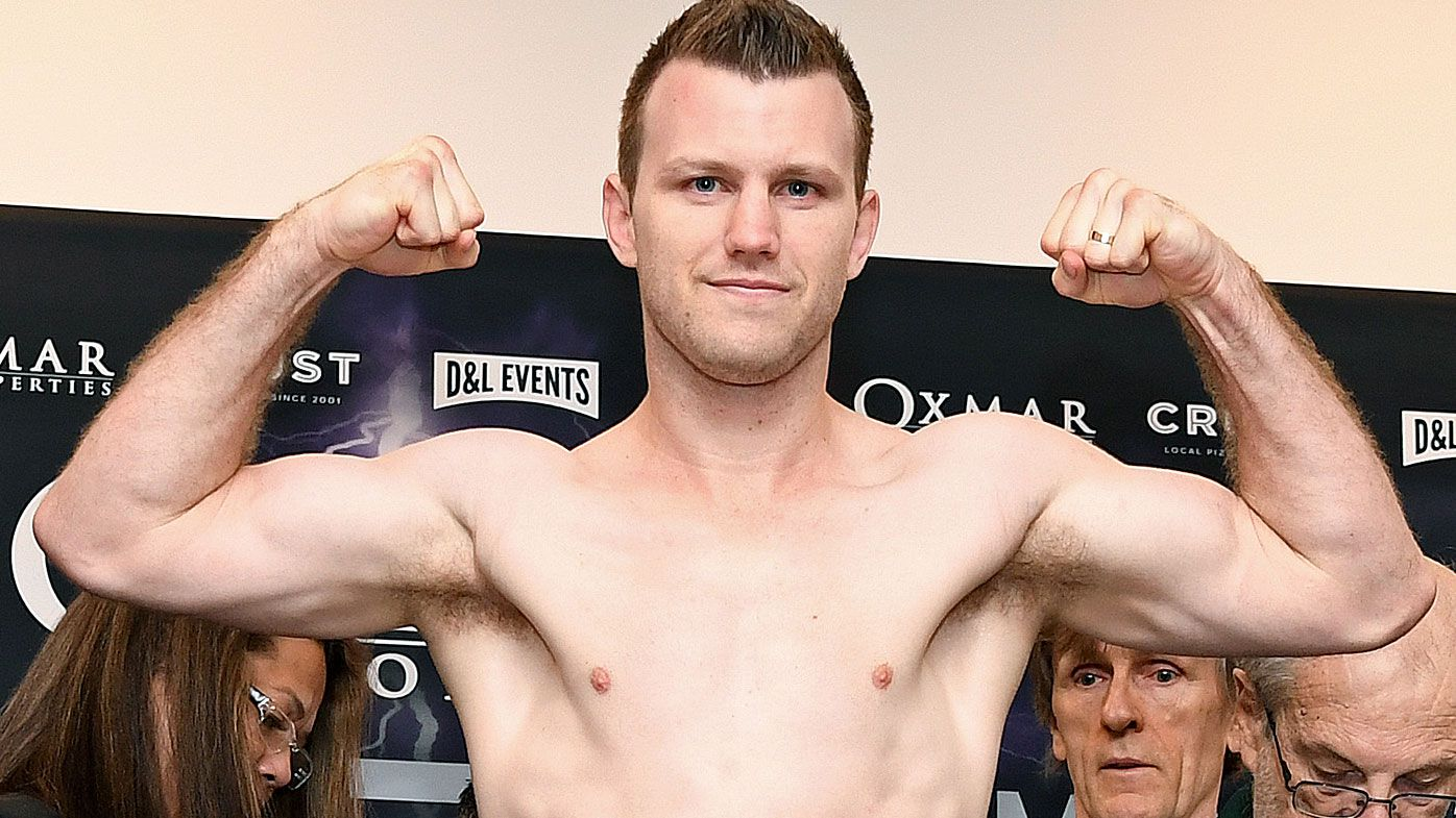 Jeff Horn jumps on the scales and makes weight