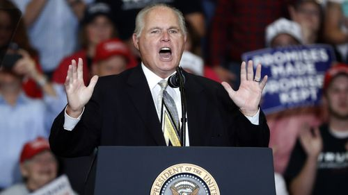 Late American radio personality Rush Limbaugh introducing President Donald Trump at the start of a campaign rally.