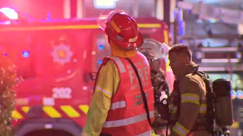 Trapped people jump from second storey of Adelaide building to escape 'deliberately lit' fire