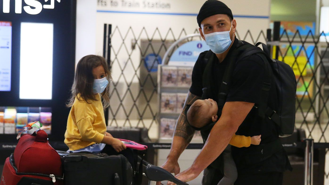 Sonny Bill Williams touches down in Sydney with family. (Getty)