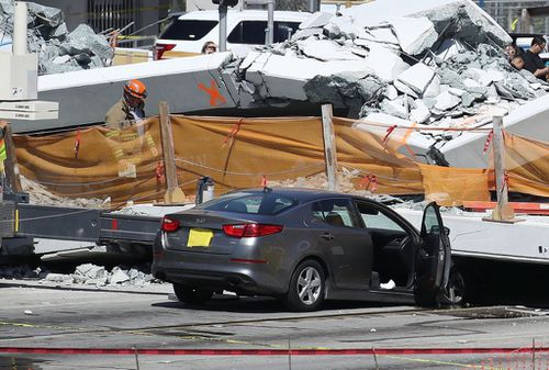 Authorities have confirmed eight cars are trapped beneath the rubble of the bridge. (Getty)
