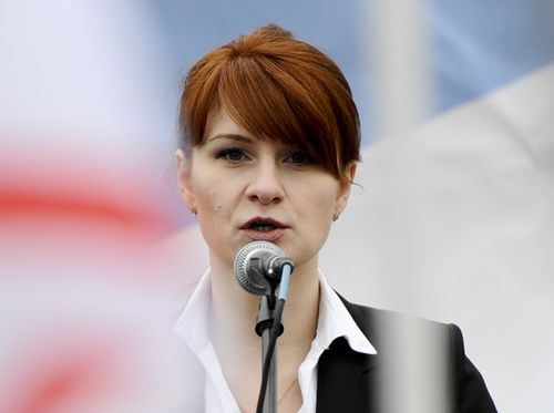 In this photo taken on Sunday, April 21, 2013, Maria Butina, leader of a pro-gun organization in Russia, speaks to a crowd during a rally in support of legalizing the possession of handguns in Moscow, Russia. Butina, a 29-year-old gun-rights activist, served as a covert Russian agent while living in Washington, gathering intelligence on American officials and political organisations and working to establish back-channel lines of communications for the Kremlin, federal prosecutors charged Monday, July 16, 2018. (AP Photo)