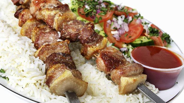 Pork skewers with rice and cucumber salad