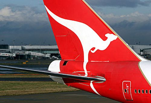Qantas jet at international airport (Getty)