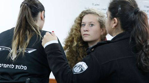 17 year old Palestinian Ahed Tamimi (C), a campaigner against Israel's occupation, appears at a military court at the Israeli-run Ofer prison in the West Bank village of Betunia (EPA/ABIR SULTAN)