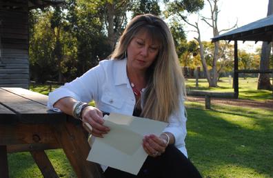 Michelle reading letter