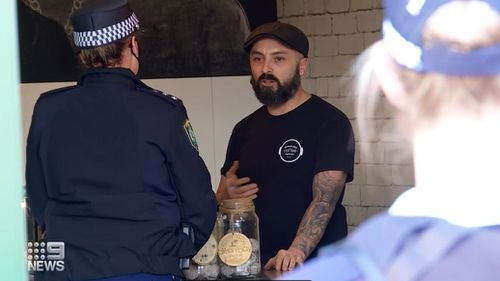 A NSW cafe owner has been fined for refusing to wear a mask.