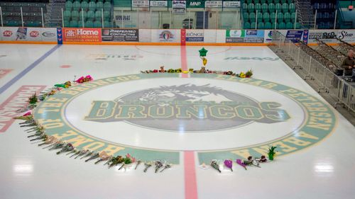Flowers are shown at centre of the ice rink as preparations are made at Elgar Petersen Arena for a vigil  in Humboldt, Saskatchewan. (AP).