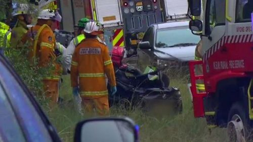 Emergency services at the scene of the crash. (9NEWS)