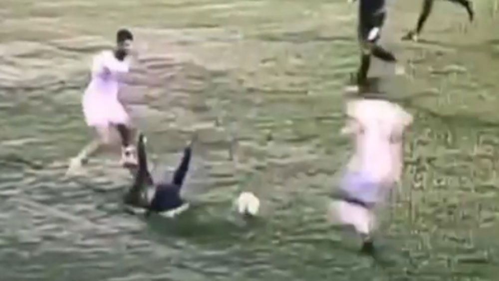 Football: Disgraceful kick sparks all-out brawl