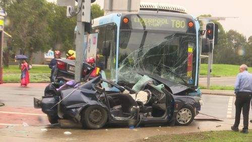 Two people are critical after a bus and car crash in Liverpool.