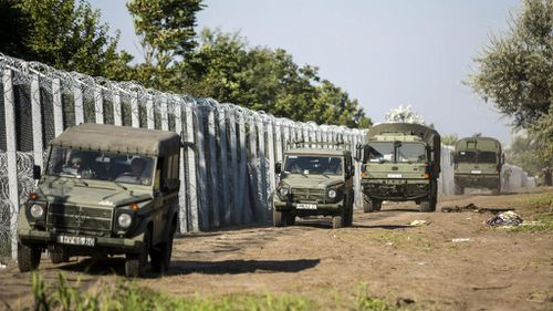 Hungary arrests migrants as borders shut around Europe