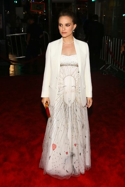 <p>Heavenly body: Wearing Christian Dior dress embroidered with stars and sun, at 'Jackie' film premiere.</p>