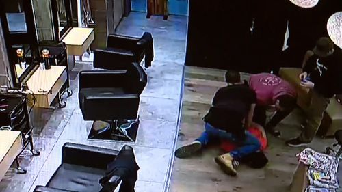 At least five undercover officers could be seen arresting the suspect. Picture: Supplied