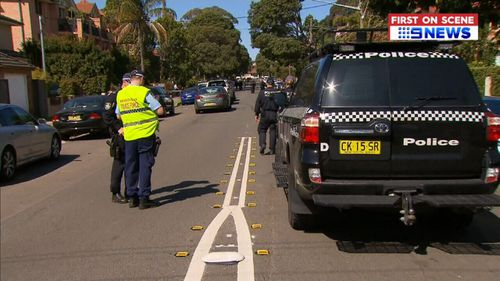 Police locked down a street in Sydney's inner west today after a man was shot in broad daylight.