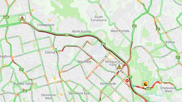 Traffic is backed up more than 10 kilometres on Sydney's M2 Motorway after a westbound truck lost pipes containing asbestos.