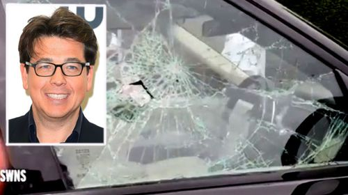 Comedian Michael McIntyre's Range Rover was smashed with a hammer in north London by moped riding thugs. (Photos: AAP/SWNS).