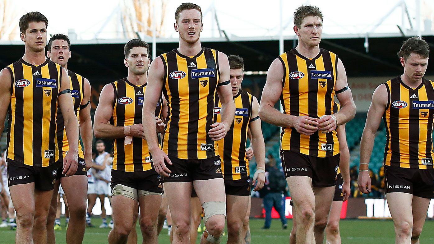 Hawthorn players leave the field after being thrashed by Fremantle.