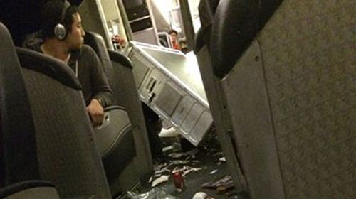 A photo uploaded to Marc Stanley's Facebook page shows the drink cart that was knocked over due to the intense turbulence. (Supplied)