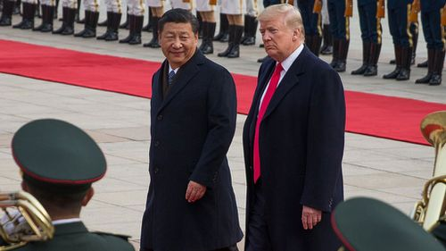 US President Donald Trump and Chinese President Xi Jinping review soldiers in China during a welcome ceremony at the Great Hall of the People in Beijing on Thursday (Image: EPA)