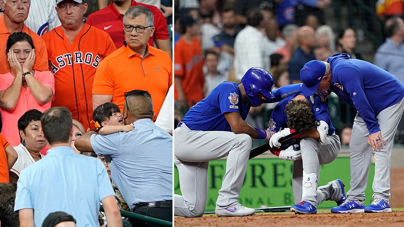 Chicago Cubs' Albert Almora Jr., center, takes a knee as Jason Heyward, left, and manager Joe Maddon, right, talk to him after hitting a foul ball into the stands
