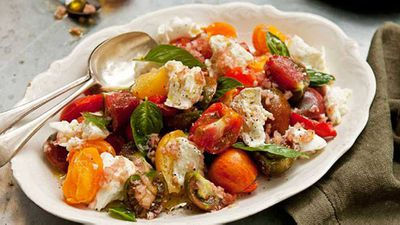 """Appreciate the sweetness of in-seaon heirloom tomatoes with our rainbow <a href=""""http://kitchen.nine.com.au/2016/05/16/11/22/tomato-caprese-salad"""" target=""""_top"""">Caprese salad</a> recipe"""