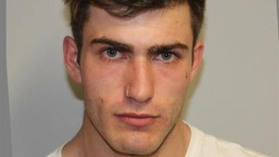 Hunt for Melbourne court escapee with distinctive tattoo
