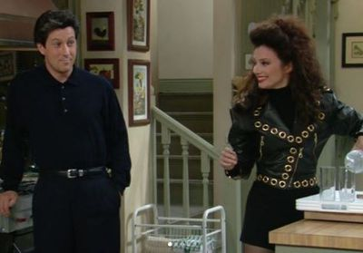 The Nanny's Fran Fine in a Michael Hoban cropped Moto Jacket with Gold hardware
