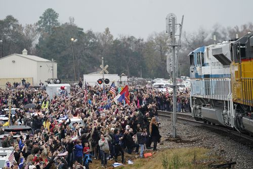 Crowds gathered to see special train 4141 pass through Texas carrying the body of the former US President.