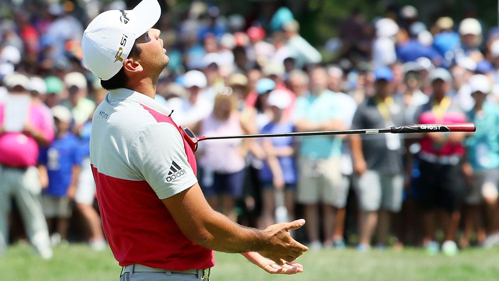 Day fights putter at PGA, Walker leads
