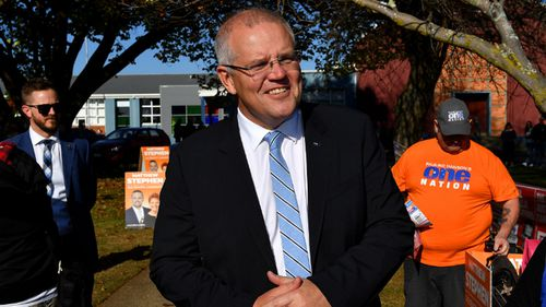 Scott Morrison continues to campaign in Tasmania on election day.