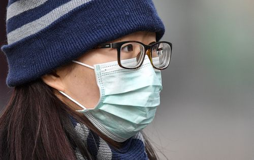A woman walks on the street with a face mask in Duesseldorf, Germany, Monday, March 2, Pictue: Martin Meissner