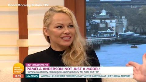 Pamela Anderson addressesromance rumours with Julian Assange