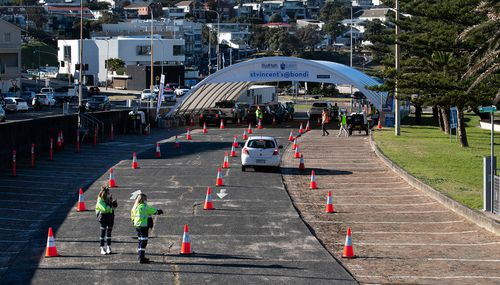 A steady trickle of cars enters the COVID-19 testing station in Bondi ahead of the weekend.