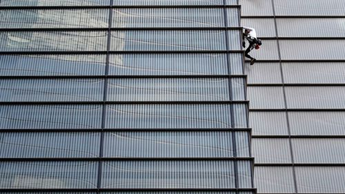 Alain Robert, dubbed the 'French Spiderman', climbed London's 230m-tall Heron Tower on Thursday local time.