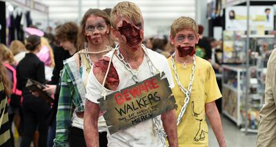 A group of terrifying young 'walkers', from The Walking Dead also attended the event. (AAP)