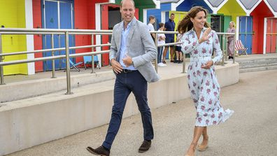 Britain's Prince William and Kate, the Duchess of Cambridge walk along the promenade in Barry Island, Wales, Wednesday Aug. 5, 2020, during their visit to speak to local business owners about the impact of COVID-19