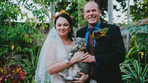 Amelia and Andrew Rankin on their wedding day in their garden- which is now devastated by the Townsville floods.