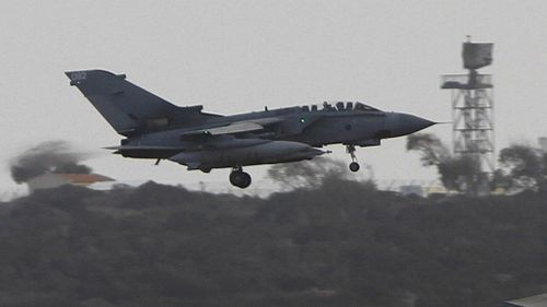A British jet returns to base on Cyprus after a scouting run over ISIL territory. (AAP)