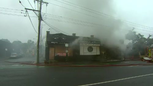 Fire tore through the popular shops this morning.