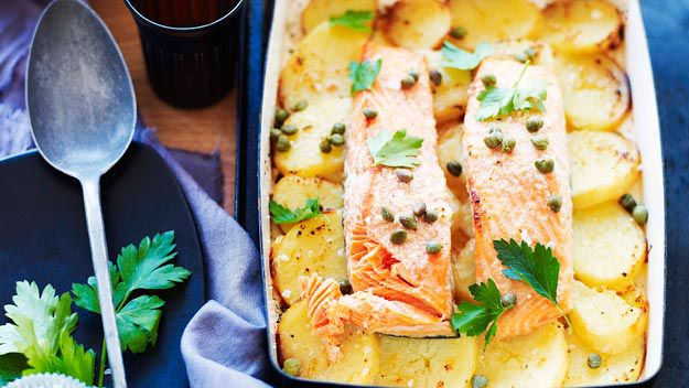 Lemon and garlic roast salmon on potatoes
