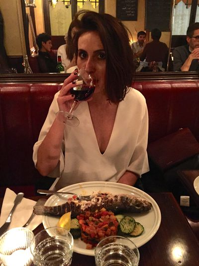 Dinner in Paris with a glass of red after a long day of appointments.