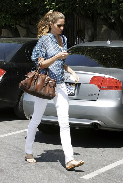 <p>Nine months of incorporating a bump into your off-duty wear doesn't mean you have to resort to parachute pants and over-sized sweats. Take a leaf out of Gisele's book with a pair of chic white jeans that can be bought post-baby.</p>