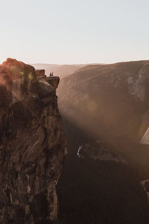 Freelance photographer Matt Dippel accidentally captured this photo of a proposal happening on Taft Point's cliff edge (Matthew Dippel).