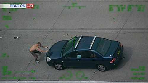 One man attempts to hijack another car. (9NEWS)