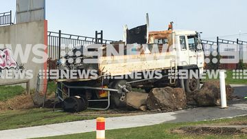 Environmental authorities are assessing if materials leaking from drums are hazardous after a truck overturned in Campbellfield.