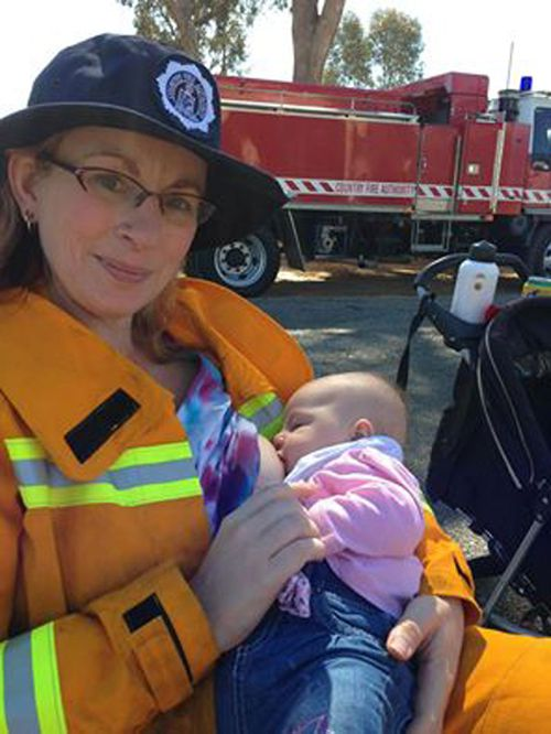 Angela Joy breastfeeds at a CFA community event. (Image: Country Fire Association/Facebook)